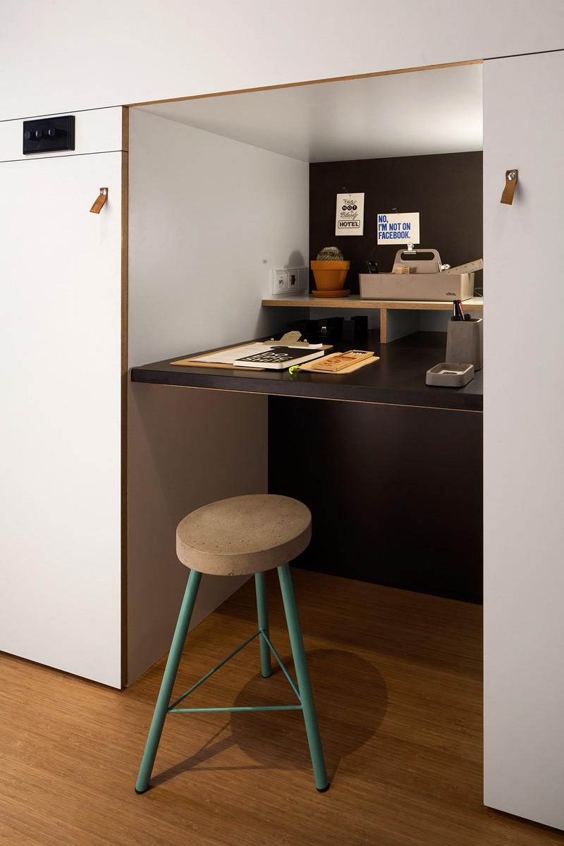 concrete-compact-hotel-room-loft-11