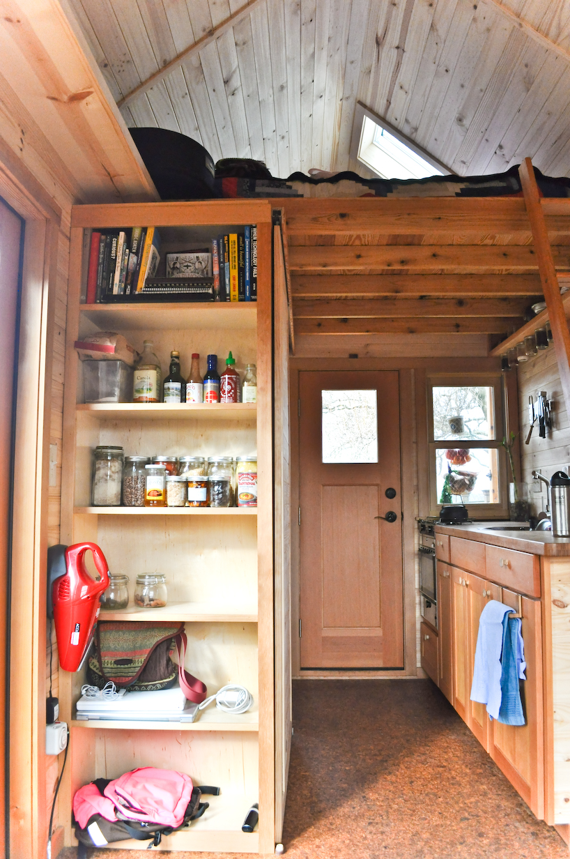row1 - Tammy is living in a 12 m2 (128 ft2) tiny house with her husband and two cats