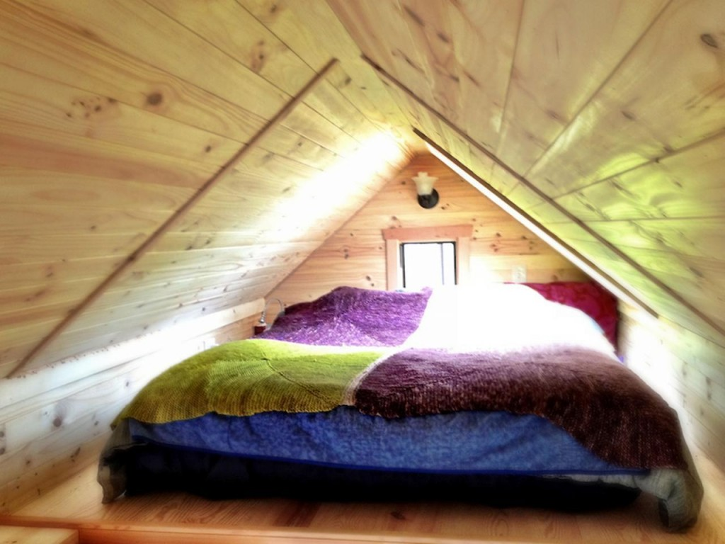 row2 - Tammy is living in a 12 m2 (128 ft2) tiny house with her husband and two cats