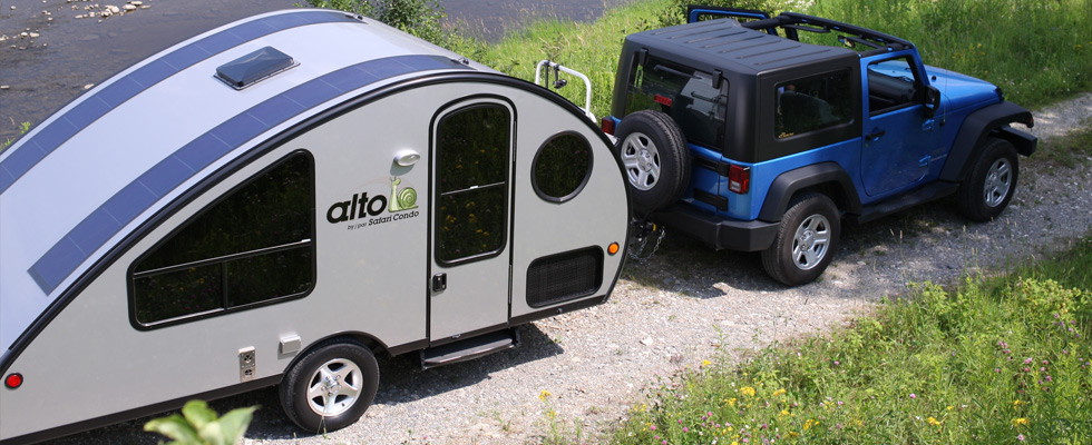 A Travel Trailer With A Retractable Roof Living In A Shoebox
