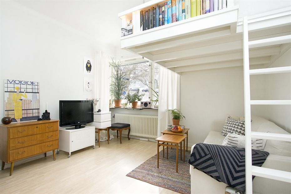 Small swedish studio apartment elegantly combines loft bed for Small efficiency apartment