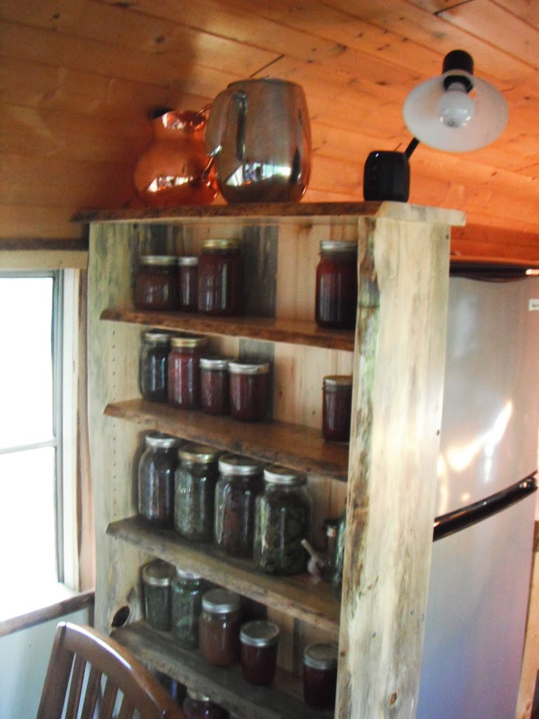 shelves - Katherine lives happily in a converted school bus with her husband, an 8-month-old baby, a dog and a cat