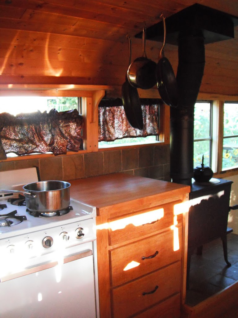 kitchen bus2 - Katherine lives happily in a converted school bus with her husband, an 8-month-old baby, a dog and a cat