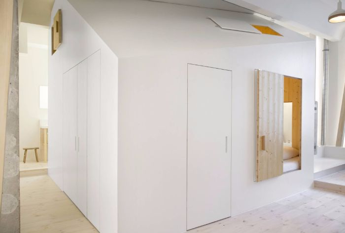 hotel room boasts a playful plywood house - living in a shoebox