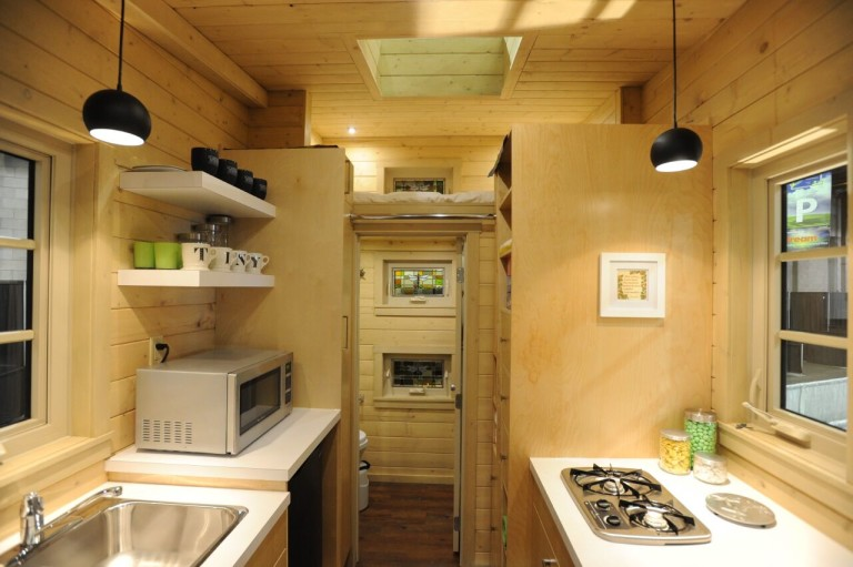 The Dragonfly Tiny House Boasts A Unique Pull out Stair