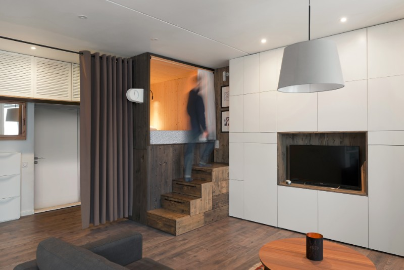The Wooden Loft Bed With Built In Storage Is Placed In A Corner Of The  Apartment. It Provides Privacy By Separating The Sleeping Quarters From The  Living ...