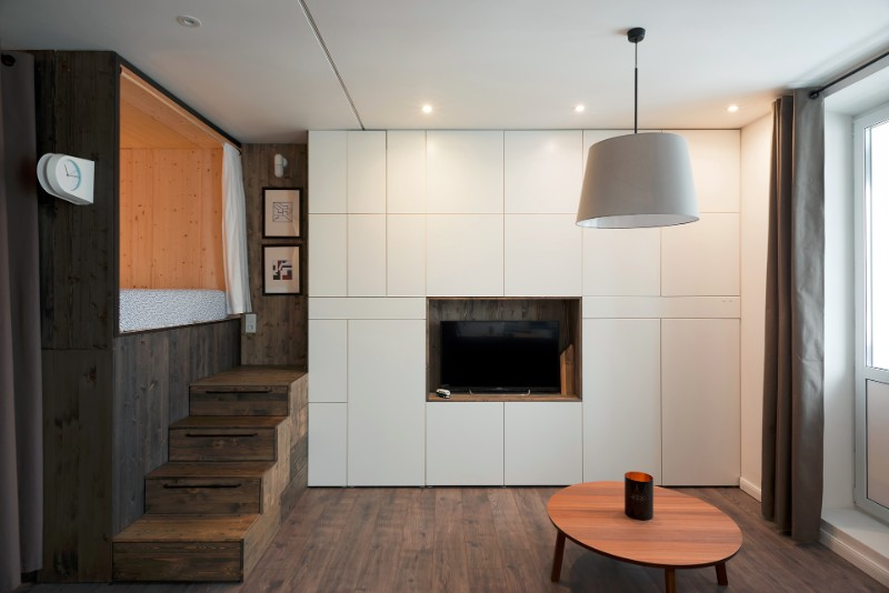 The designer s small studio apartment features an for Studio apartment storage