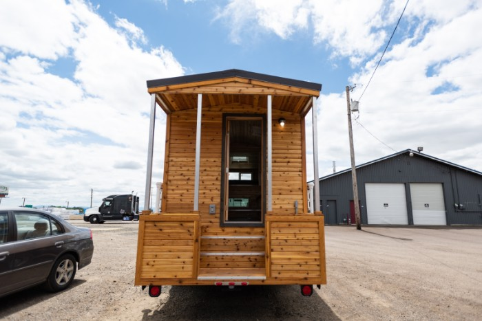 The Traveler is a truck camper with a rustic tiny house feel