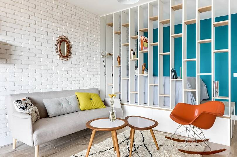 Voltaire apartment 2 - Small studio apartment uses see-through shelving as an elegant partition wall