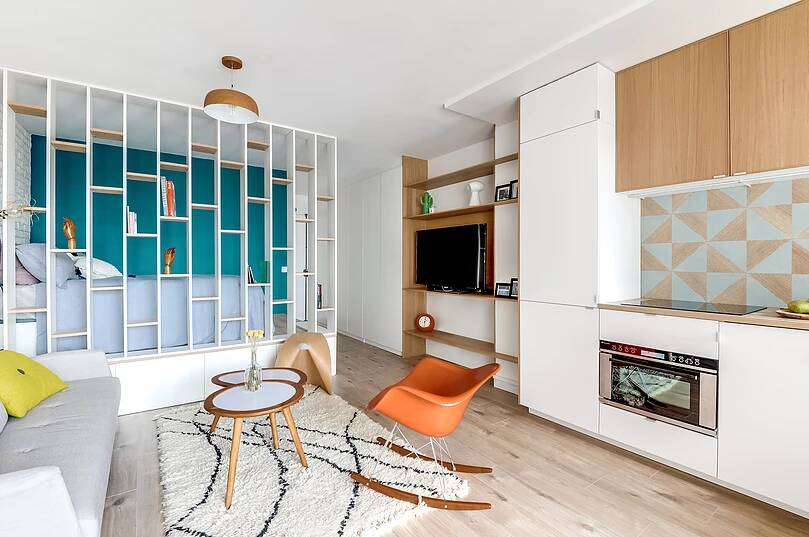 Voltaire apartment 4 - Small studio apartment uses see-through shelving as an elegant partition wall