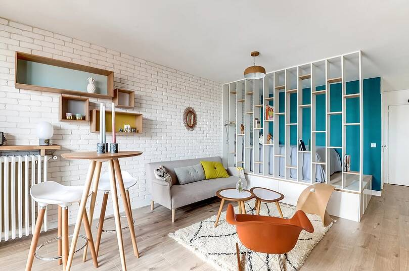 Voltaire apartment 9 - Small studio apartment uses see-through shelving as an elegant partition wall