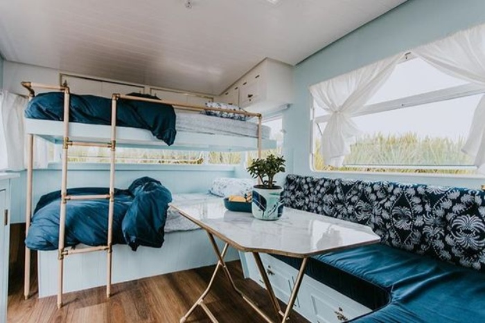 7eb705a319bde78db8cdfdfc5157c128 - Renovated vintage camper boasts a sumptuous mix of pastel blues and touches of brass