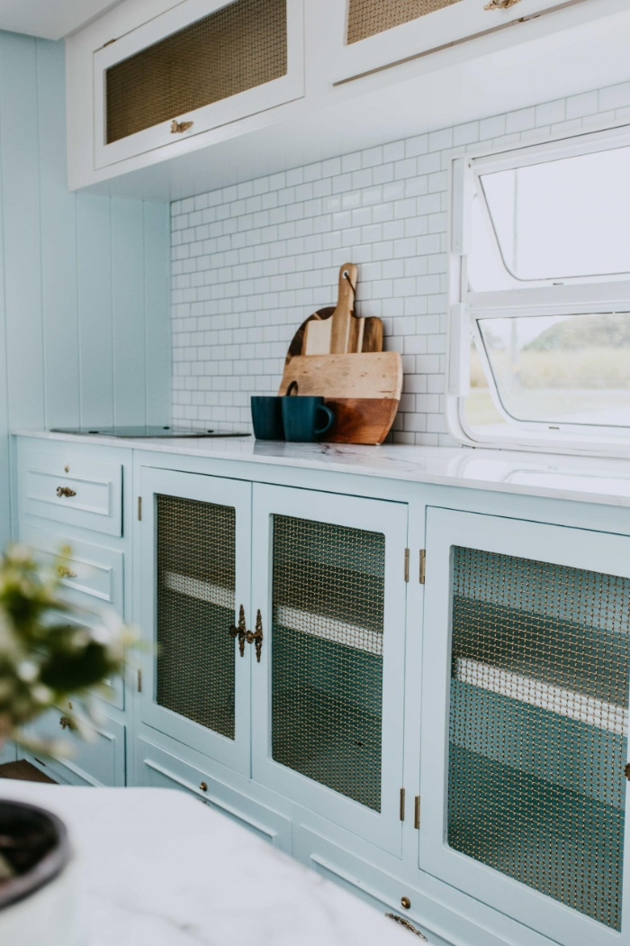 DollyCaravan CaitMiers 118 copy 700x1050 - Renovated vintage camper boasts a sumptuous mix of pastel blues and touches of brass