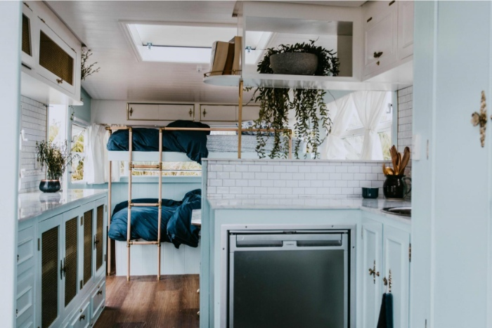 DollyCaravan CaitMiers 139 copy 700x467 1 - Renovated vintage camper boasts a sumptuous mix of pastel blues and touches of brass