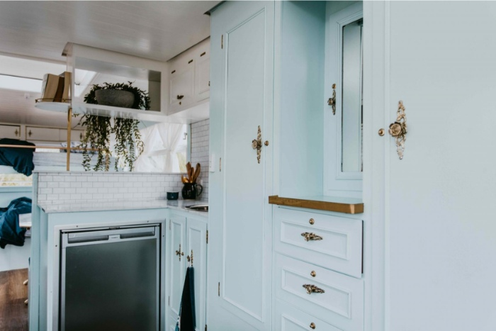 DollyCaravan CaitMiers 140 copy 700x467 - Renovated vintage camper boasts a sumptuous mix of pastel blues and touches of brass