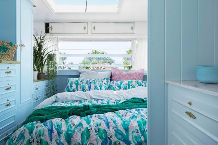 Tropical Paradise Carlene Duffy Pedro Parrot Landscape SS18 copy 700x467 - Renovated vintage camper boasts a sumptuous mix of pastel blues and touches of brass
