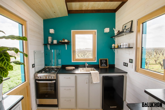 tiny house baluchon 11 - Colorful tiny house boasts staircase with built-in dog nook and sitting area