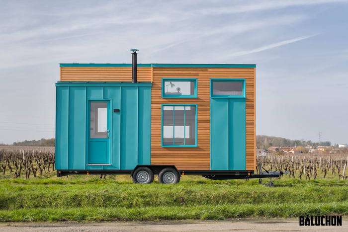 tiny house baluchon 12 - Colorful tiny house boasts staircase with built-in dog nook and sitting area
