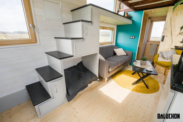 tiny house baluchon 8 - Colorful tiny house boasts staircase with built-in dog nook and sitting area
