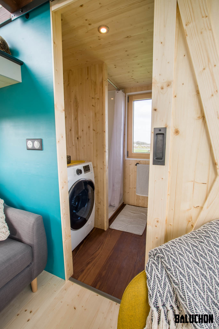 tiny house baluchon 9 - Colorful tiny house boasts staircase with built-in dog nook and sitting area