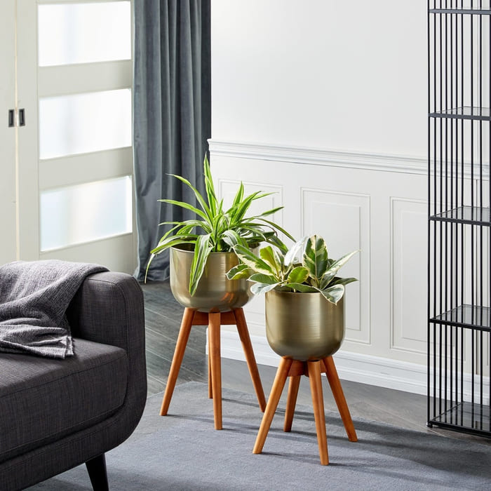 Gold Metal Planters With Wood Base Set Of 2 21  X 24  - Give your favorite plant a fabulous makeover with one of these 25 planters