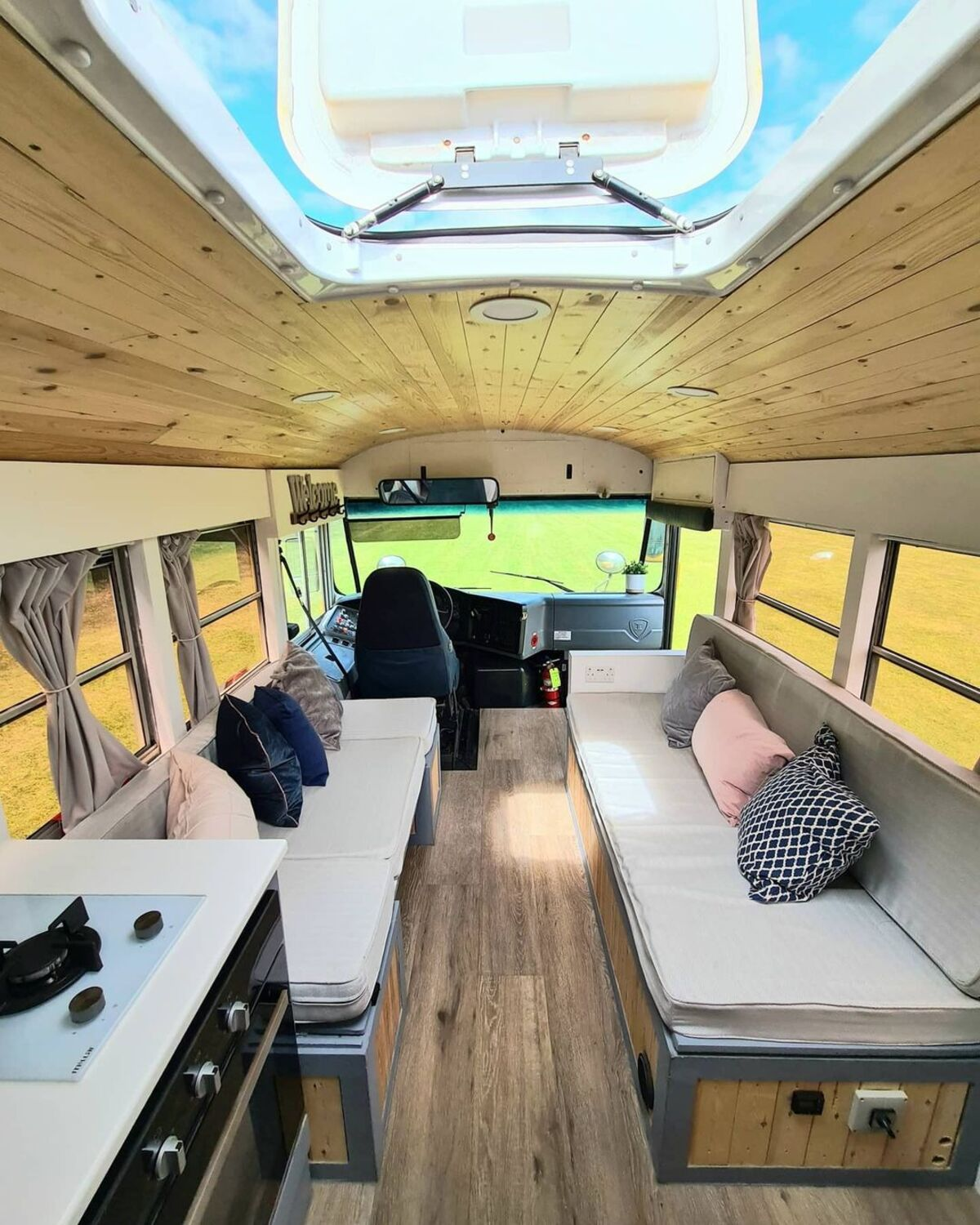 skoolie win 17 - British couple turned school bus into home complete with mini cinema - they are now raffling it off