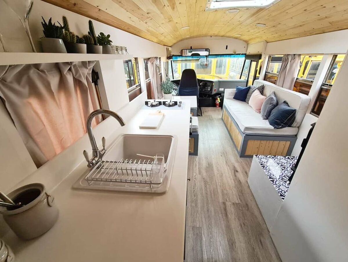 skoolie win 4 - British couple turned school bus into home complete with mini cinema - they are now raffling it off