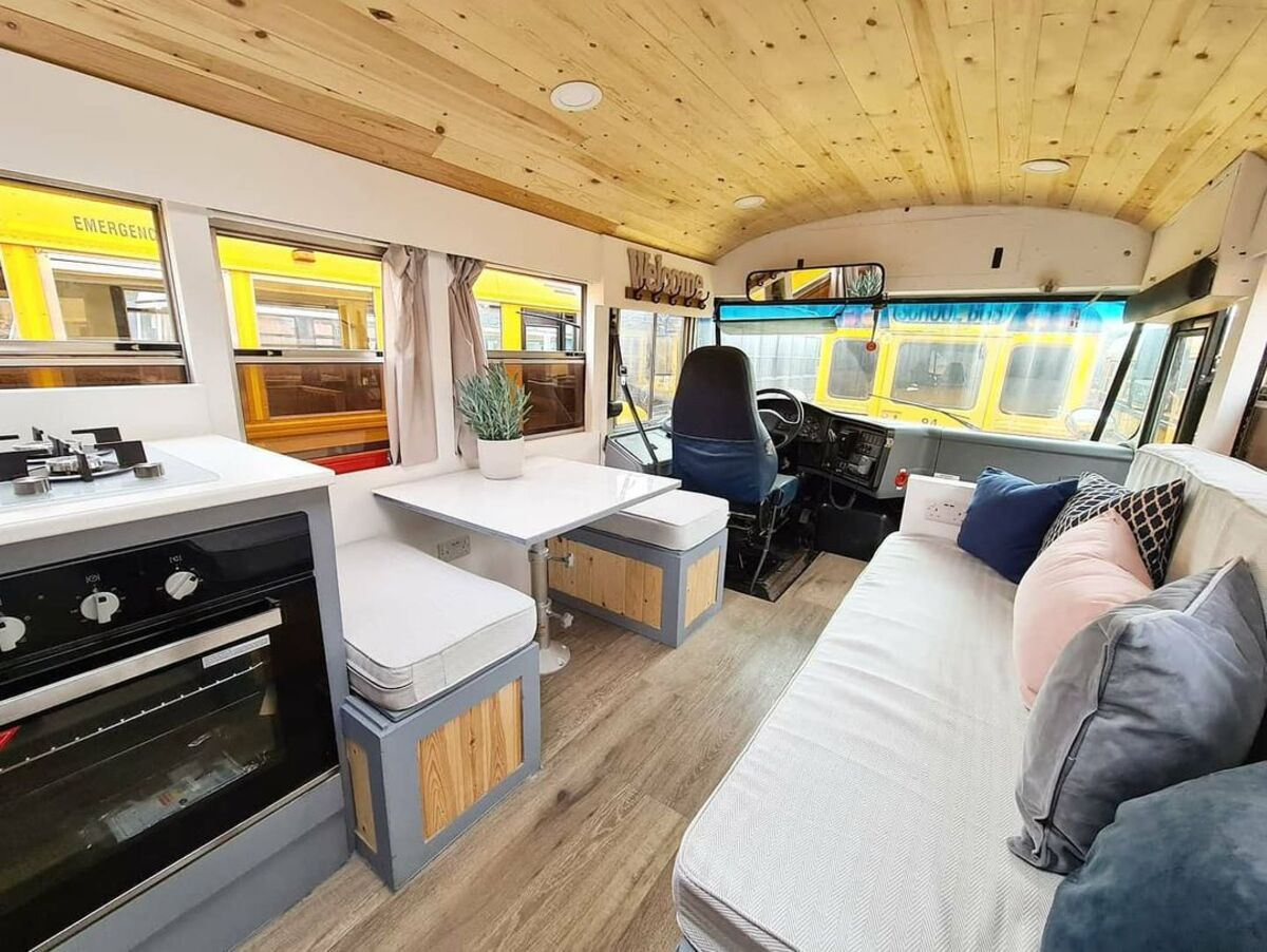 skoolie win 6 - British couple turned school bus into home complete with mini cinema - they are now raffling it off