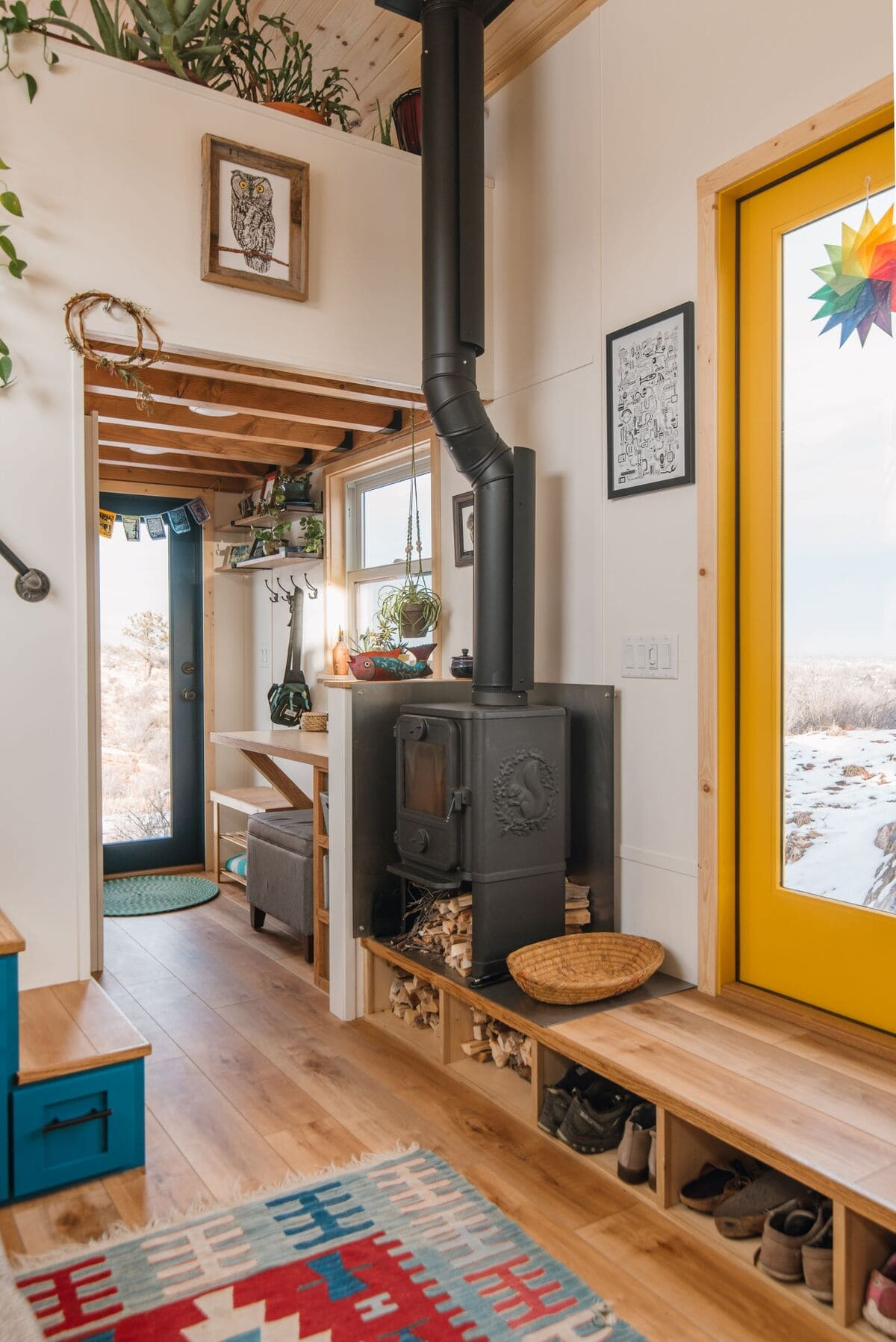 Ltiny house living Room Closeup Woodstove 1 - This luxurious tiny house does not hold back on function - it even has a mudroom