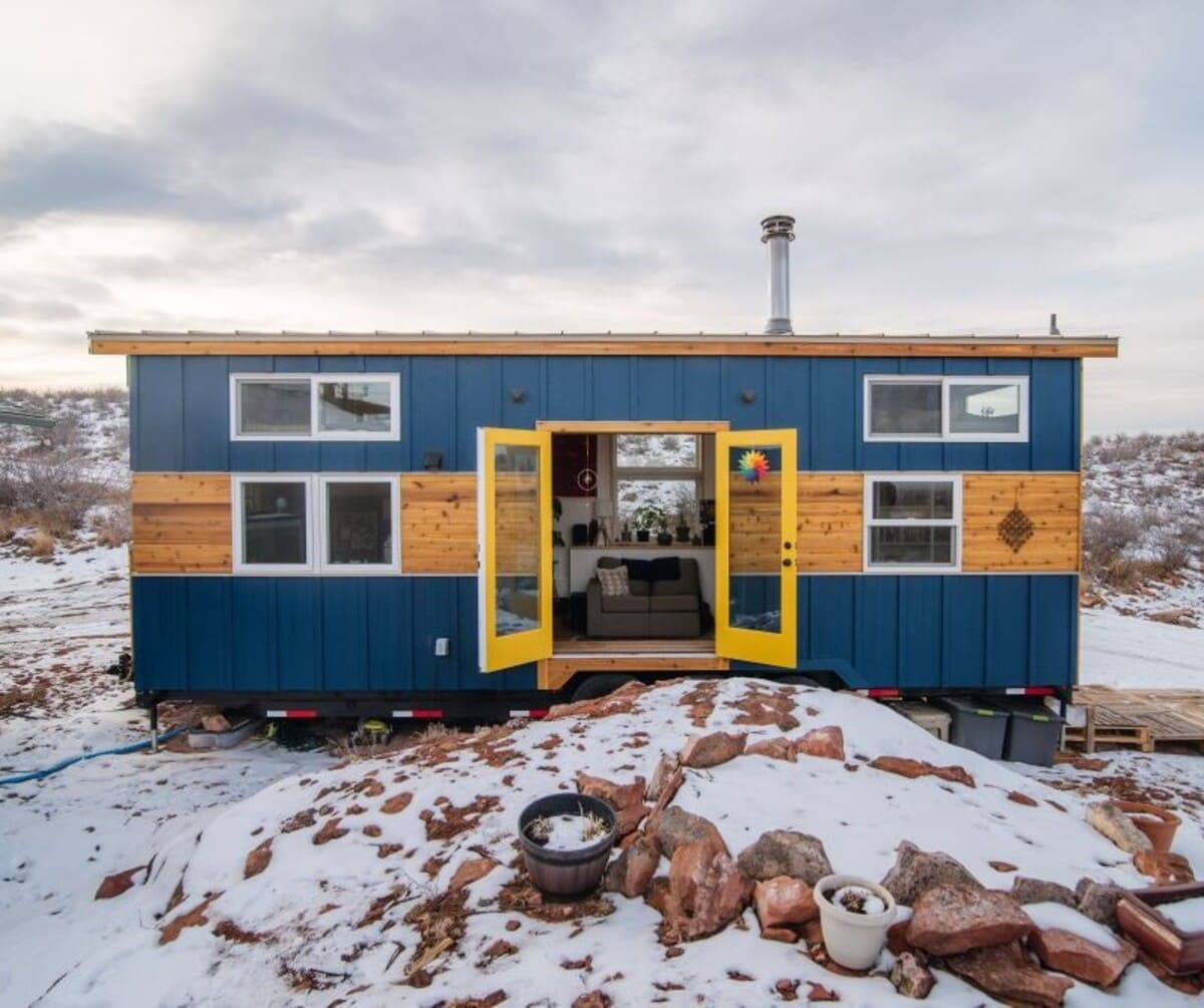 tiny house Exterior Drivers Side Doors Open - This luxurious tiny house does not hold back on function - it even has a mudroom