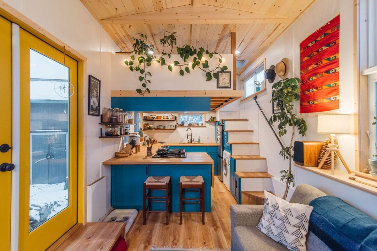 tiny house Kitchen View with Lights - This luxurious tiny house does not hold back on function - it even has a mudroom